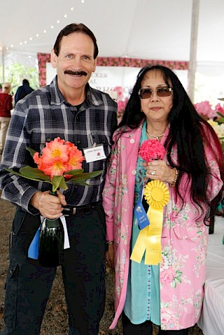 Sweepstakes winners, Dennis and Valerie McKiver show off some of their winning trusses. Photo by Dick Jones, Noyo Chapter American Rhododendron Society gallery image